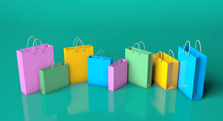 Colored paper shopping bags on a green background. 3d render 免版税图像