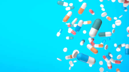 Colored pills and capsules on a blue background. Copy space for text. 3d render Imagens