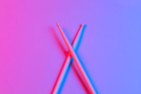 Drum sticks in neon light Фото со стока