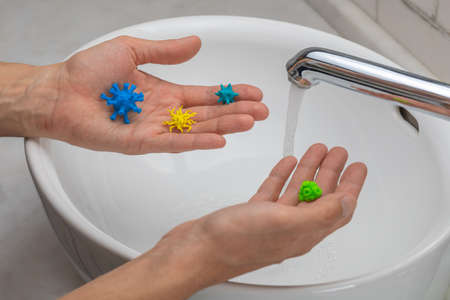 Viruses in the hands of a man. Hand washing.
