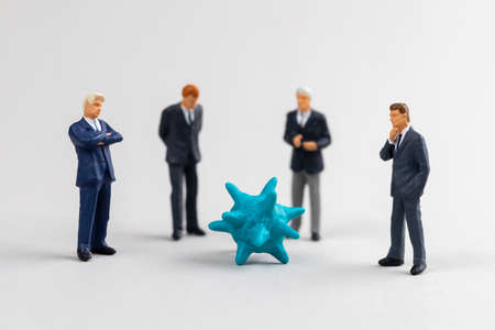 Virus and businessmen. Business adaptation to the pandemic. Stock Photo