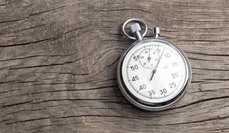 Stopwatch on old wooden background. Template Copy space for text