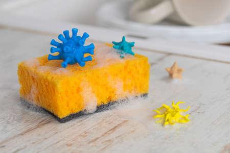 Viruses and germs on the dishwashing sponge. Concept change the sponge more often. Stock Photo