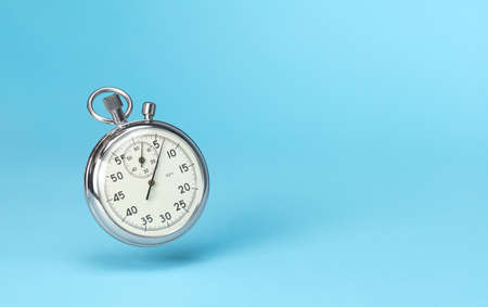 Stopwatch in levitation on blue background. Template Copy space for text
