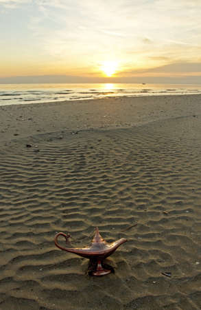 magic lamp at sunrise on the beach photo