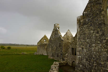 Overcast landscape of Ross Friary, Ireland  photo
