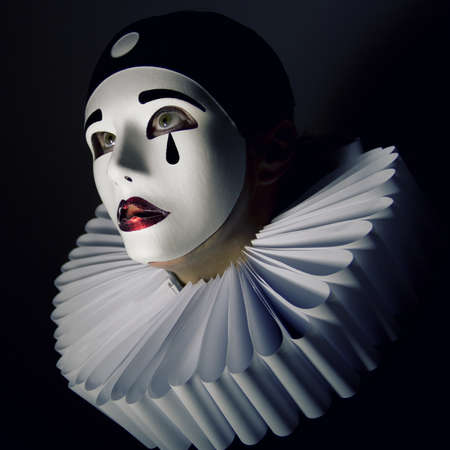 Girl with mask Pierrot Standard-Bild