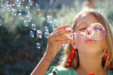 Girl with soap bubbles Standard-Bild