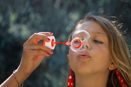 Girl with soap bubbles photo
