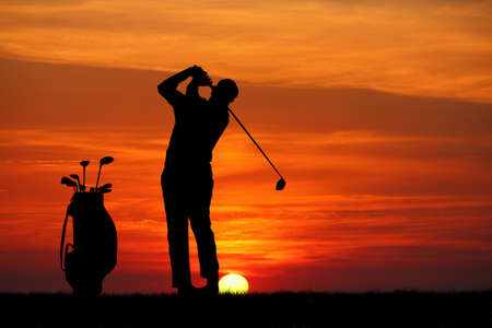 head start: Golf silhouette at sunset Stock Photo