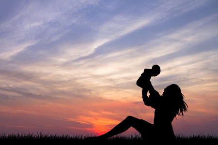 mother with baby on sunset photo
