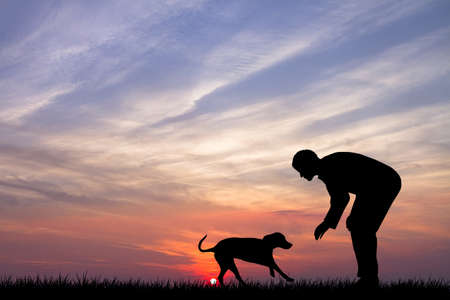 Man with dog at sunset Stock Photo - 15695399