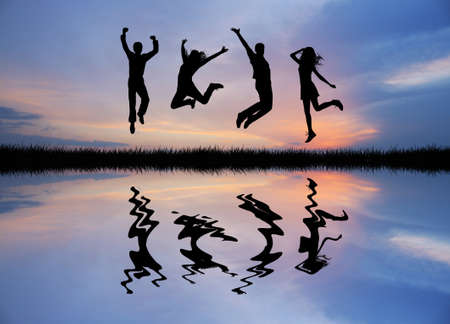 people jumping at sunset photo