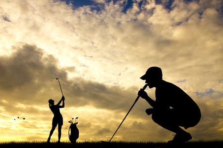 golfers at sunset photo