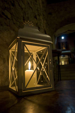Lantern with burning candle photo
