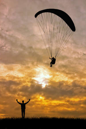 Paraglider at sunset photo