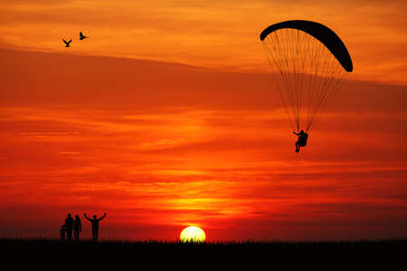 wind force: Paraglider at sunset Stock Photo