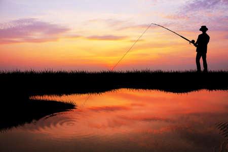 fishing at sunset Stock Photo - 16885735