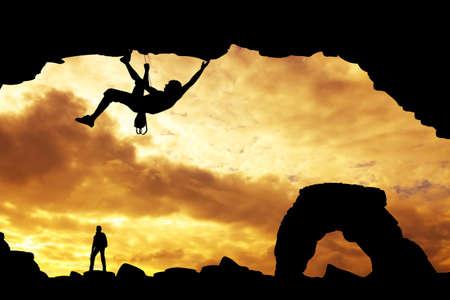 dare: free climber at sunset