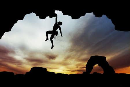 adrenalin: man climbs Stock Photo