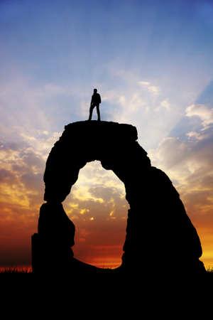 man on rock at sunset Stock Photo