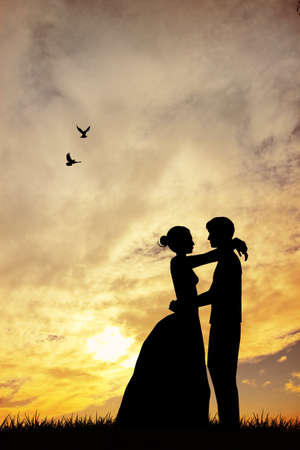 Bride and groom at sunset photo