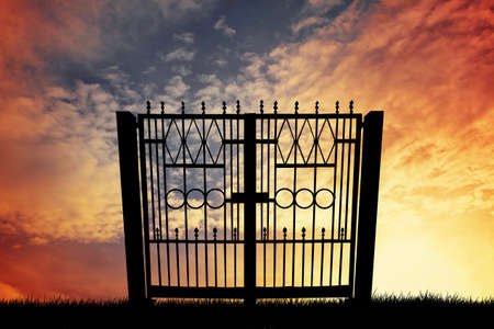 medieval blacksmith: Gate silhouette at sunset Stock Photo