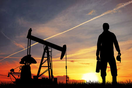 drilling machine: Oil pump at sunset Stock Photo