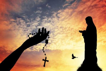 Praying with rosary Standard-Bild