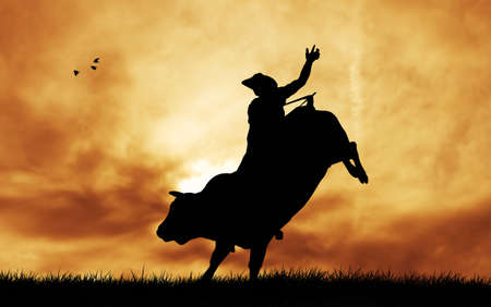 Bull rider at sunset photo