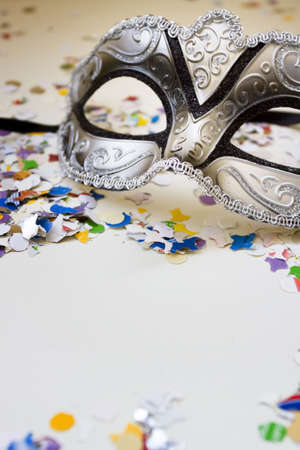 Carnival mask and confetti Stock Photo