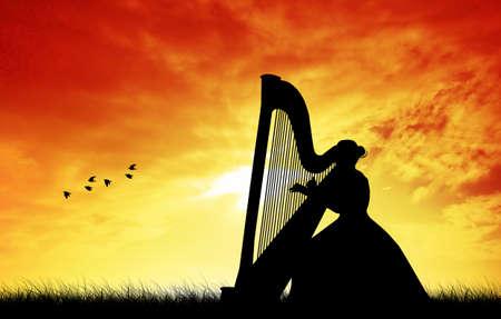 woman playing the harp photo