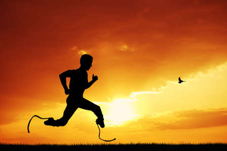 man runs with prosthetic legs Stock Photo