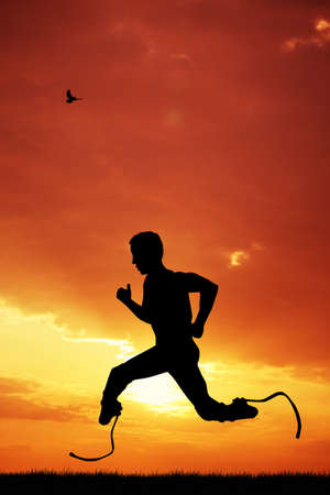prosthetic: man runs with prosthetic legs Stock Photo