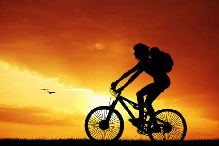 bicycler: Biker at sunset