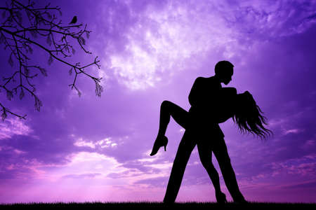 Couple dancing at sunset photo