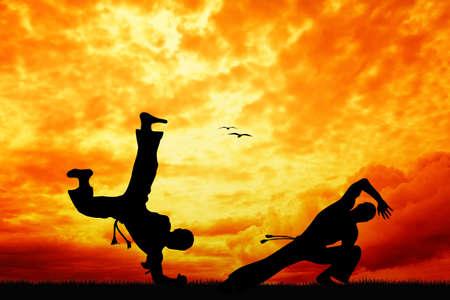 Capoeira bij zonsondergang Stockfoto