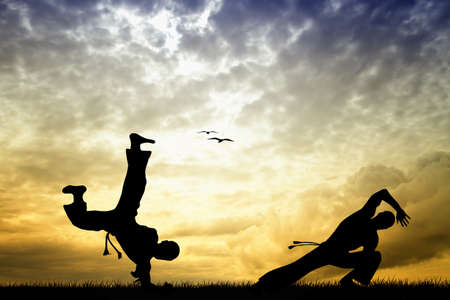 backlighting: Capoeira silhouette at sunset