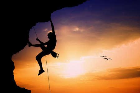 Free climbimg at sunset Stock Photo