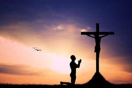 man pray silhouette at sunset Stock Photo