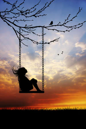 Girl on swing photo