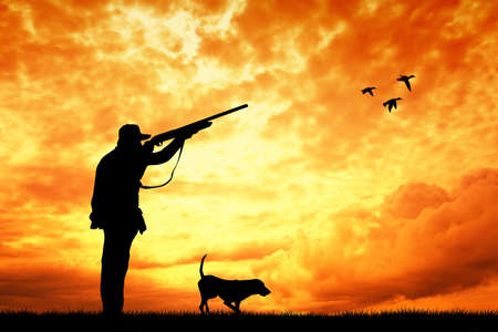 duck hunting: hunter at sunset Stock Photo