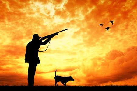 Jager bij zonsondergang Stockfoto - 22528458