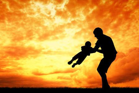 Vader en zoon bij zonsondergang