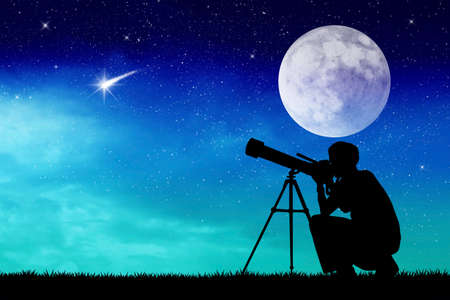 Man looks into the telescope photo