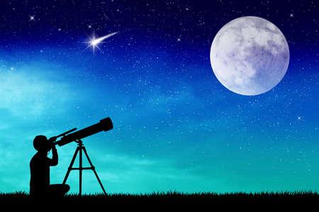 Man looks into the telescope photo