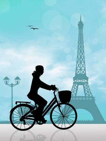 eiffel tower: woman on bike in Paris