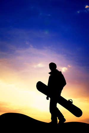 afterglow: snowboarder at sunset