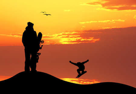 snowboarder silhouette at sunset