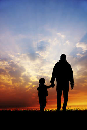 Father and son at sunset Stock Photo